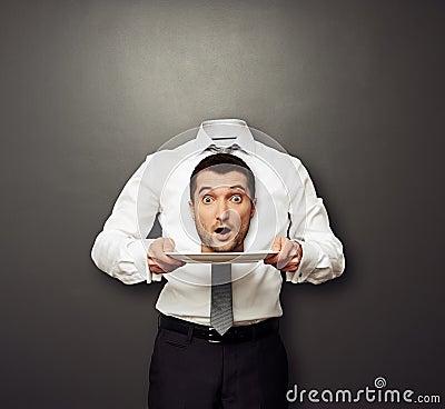 Headless man holding surprised head