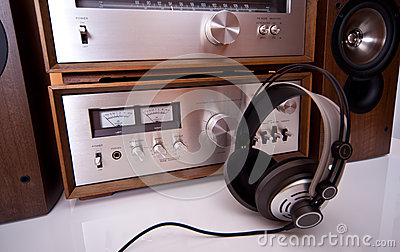 Headphones connected to vintage audio stereo