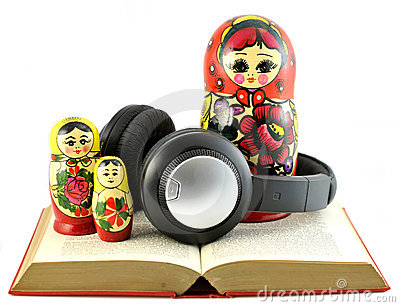 Headphones with Russian dolls in open book