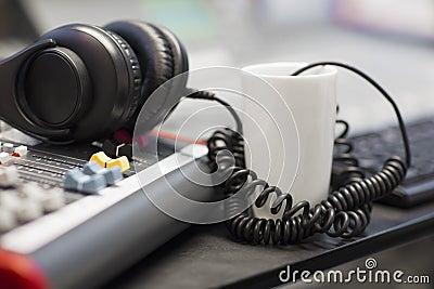 Headphones With Spiral Cord In Radio Studio Stock Photo