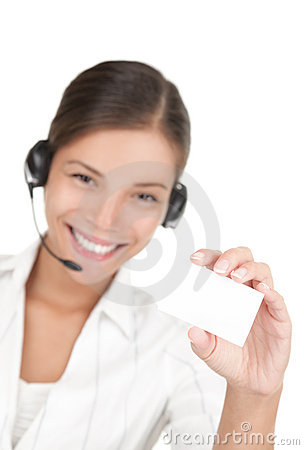 Headset woman holding business card
