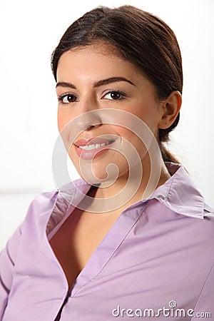 Headshot of beautiful smiling young business woman
