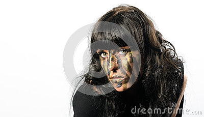 Headshot of darkhaired girl with facepaint streaks
