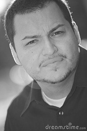 Headshot of a Latino man