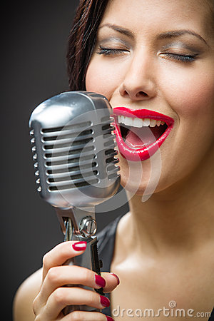 Free Headshot Of Female Singer With Closed Eyes Keeping Microphone Stock Photos - 35294423
