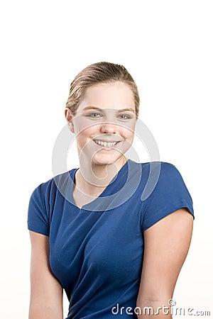 Headshot portrait of teenage girl in blue blouse