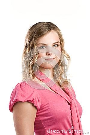Headshot portrait of teenage girl in pink blouse