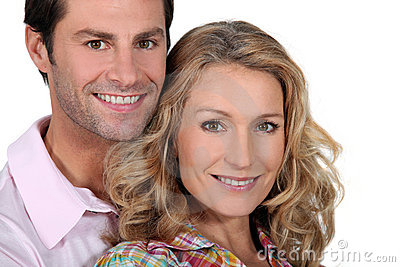Headshot of smiling couple