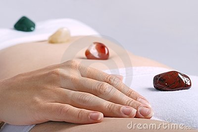 Healing by gems laid on body chakras