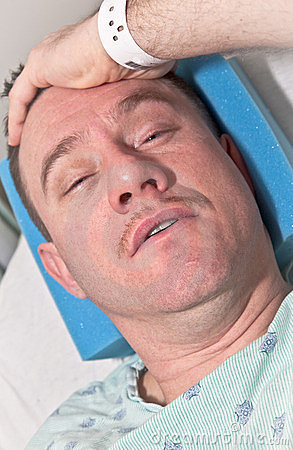 Health Care: Man in Hospital Bed