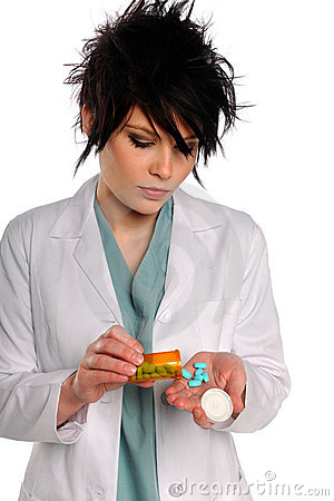 Health Care Professional With Prescription Pills