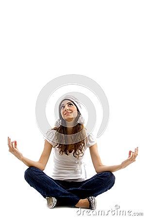 Health conscious girl doing meditation