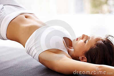 Health conscious - Woman doing yoga exercise