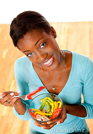 Health conscious woman eating salad