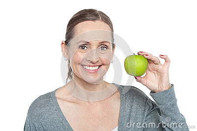Health conscious woman holding fresh green apple