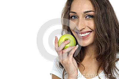 Health conscious woman about to eat fresh green apple