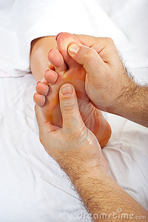 Health worker give reflexology massage