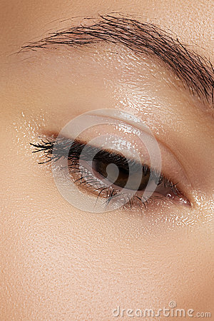 Healthcare and cosmetics. Close-up of woman s eye