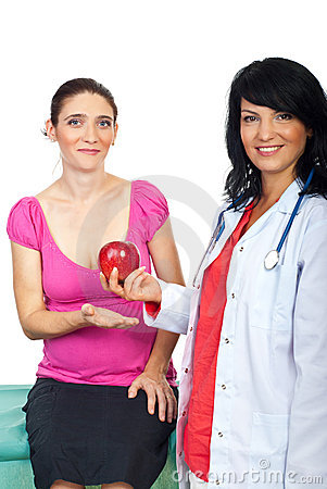 Healthcare doctor give apple to patient