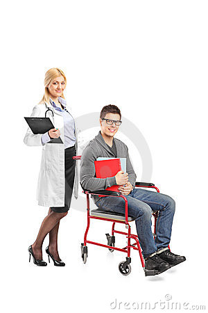 Healthcare practitioner pushing man in wheelchair