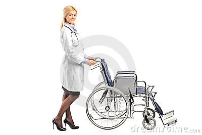 Healthcare professional pushing a wheelchair