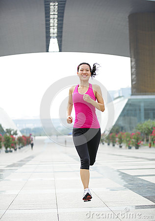 healthy asian woman jogging at city