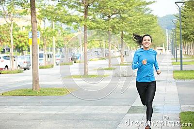 Healthy asian woman jogging