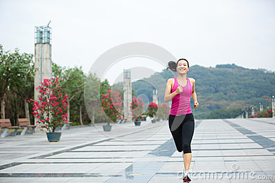 Healthy asian woman jogging