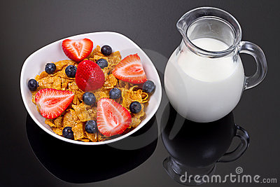 Healthy breakfast with fruity corn flakes and milk