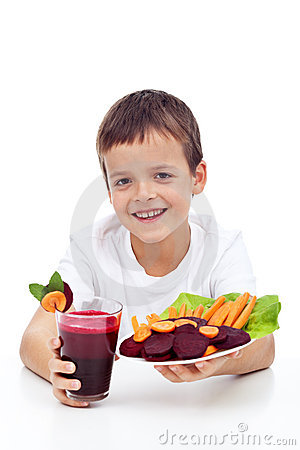 Healthy child with fresh beetroot juice