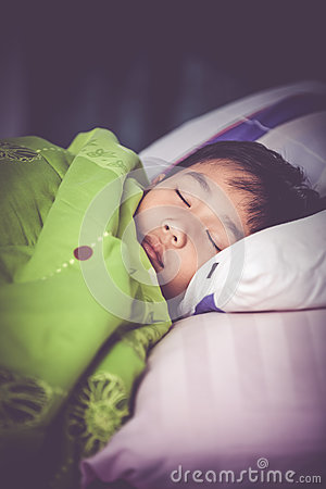 Free Healthy Child. Little Asian Boy Sleeping Peacefully On Bed. Vint Royalty Free Stock Images - 85250179