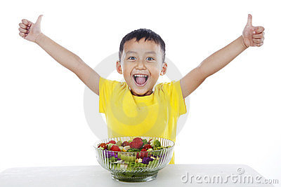 Healthy child with salad