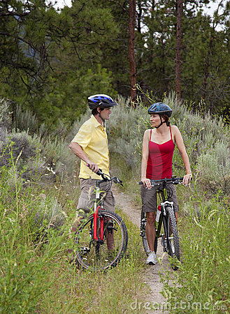 Healthy Couple on Bikes in a Forest