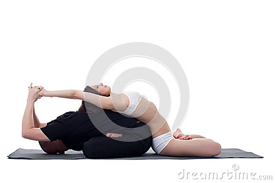 Healthy couple doing yoga and meditating