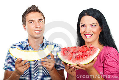 Healthy couple with watermelon and melon