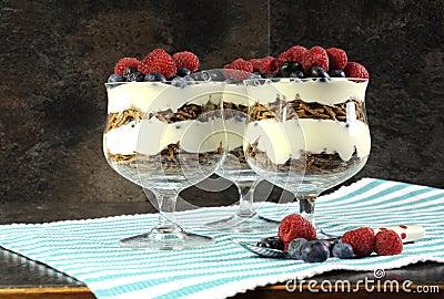 Healthy diet high dietary fiber breakfast with bran cereal, yoghurt and berries sundaes