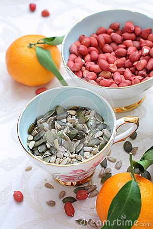 Healthy diet, mixed seeds, peanuts and clementines