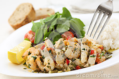 Healthy dish of fried chicken and shrimps with watercress