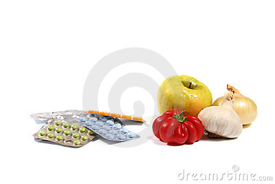 Healthy eating concept: tablets and vegetables