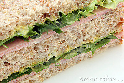 Healthy egg ham mustard and mayonnaise brown bread sandwich