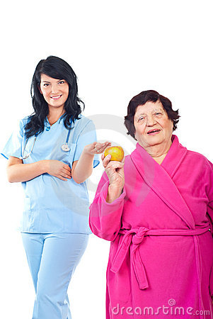 Healthy elderly holding apple