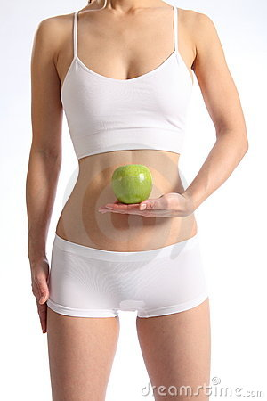 Healthy female torso white underwear holding apple