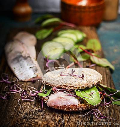 Free Healthy Fish Sandwich With Herring, Cucumber And Sprouts On Rustic Kitchen Table Royalty Free Stock Images - 63687739