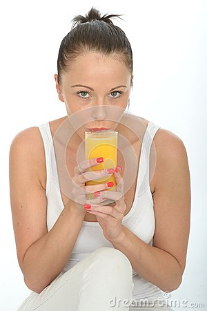 Free Healthy Fit Young Woman Drinking A Glass Of Fresh Orange Juice Stock Photography - 53031792