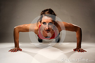 Healthy Fitness Woman doing a Pushup