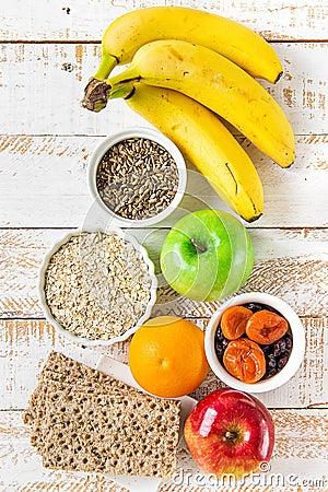Free Healthy Food Fiber Source Breakfast Oatmeal Fruits Apples Green Red Bananas Orange Milk Thistle, Rye Bran Scandinavian Crispbread Stock Photography - 101580262