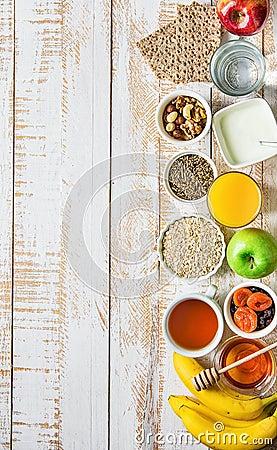 Free Healthy Food Fiber Source Breakfast Oatmeal Honey Fruits Apples Banana Orange Juice Water Green Tea Nuts. White Plank Wood Table Royalty Free Stock Image - 101471596