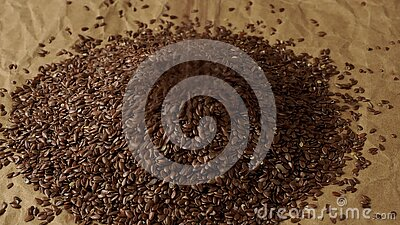 Healthy food organic nutrition. Flax seeds linseed heap. On paper background