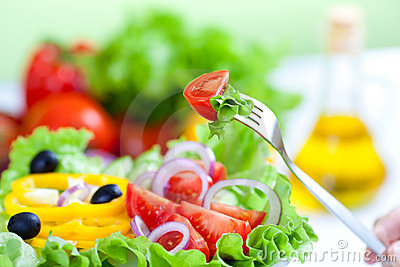 Healthy fresh vegetable salad and olive oil