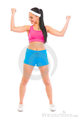 Healthy girl checking muscles